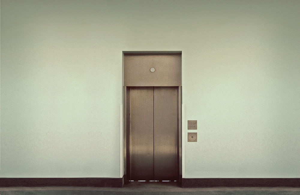 Imagine that you're inside this elevator. There are no windows and you can't see out.