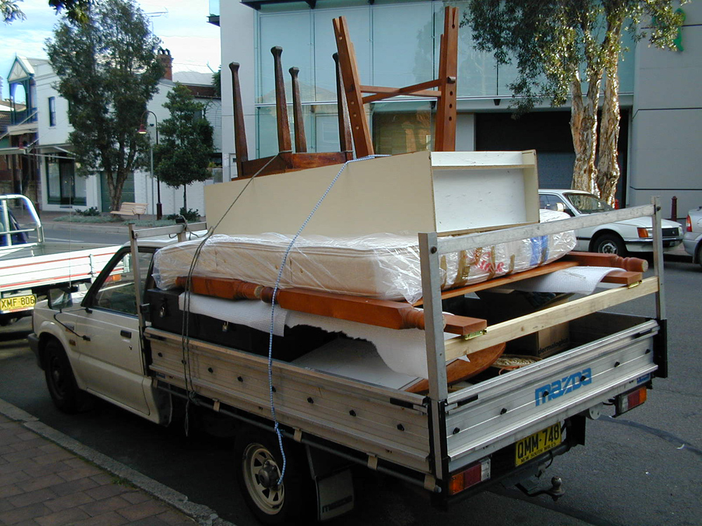 I deleted nearly all my photos from those times, but I still have this one of my final move from North Sydney to the Blue Mountains in 2002. I still have most of this furniture. Unfortunately I don't still have the VH Commodore on the other side of the road.